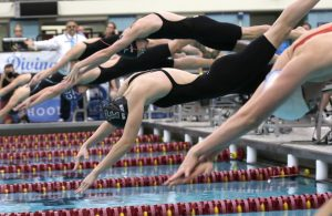 Swimmers start off the blocks of the championship final heat of the Girls 50 yard freestyle during the Girls' Swimming and Diving State Meet on Nov. 18th, 2017. (Matthew Weber / Pioneer Press)