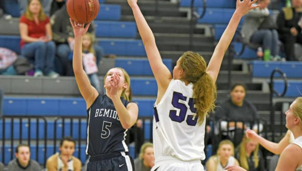 Bemidji High School freshman Lindsey Hildenbrand tosses the ball up to score for the Lumberjacks in the first half of the game against Cloquet on Saturday at BHS.