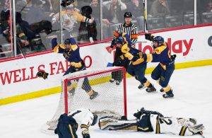 Mahtomedi forward Colin Hagstrom (4) shot the championship winning goal past Hermantown goaltender Jacob Backstrom (32) in overtime to give the Zephyrs a 3-2 victory.       ]  Shari L. Gross • shari.gross@startribune.com        Mahtomedi played against Hermantown in the class 1A boys' hockey state championship at Xcel Energy Center in St. Paul on Saturday, March 7, 2020.