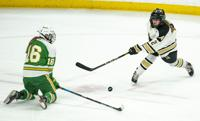 Edina forward  Emma Conner (16) blocked a shot taken by Andover defender Madison Clough (2) in the first period.    ] ALEX KORMANN • alex.kormann@startribune.com Edina took on Andover in the girl's hockey Class AA state championship on Saturday, April 3, 2021 in Xcel Energy Arena in St. Paul.