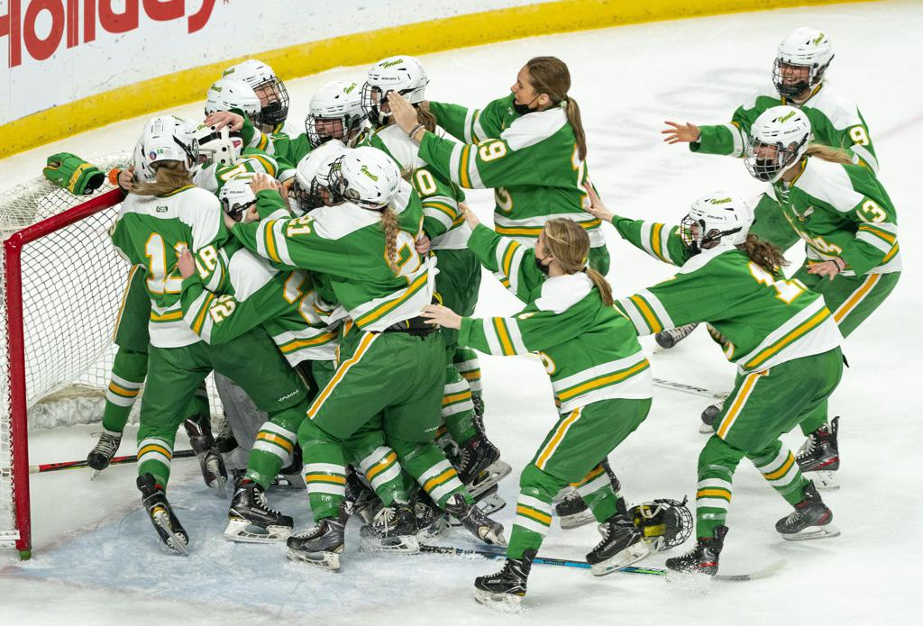 The Edina girl's hockey team celebrated after defeating Andover 2-1 to claim the Group AA state championship on Saturday.    ]  ALEX KORMANN • alex.kormann@startribune.com    Edina took on Andover in the girl's hockey Class AA state championship on Saturday, April 3, 2021 in Xcel Energy Arena in St. Paul.