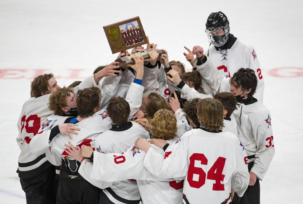 Gentry Academy players raised their trophy after winning the boy's hockey Class A state championship 8-1 over Dodge County.    ]  ALEX KORMANN • alex.kormann@startribune.com    Dodge County took on Gentry Academy in the boy's hockey Class A state championship on Saturday, April 3, 2021 in Xcel Energy Arena in St. Paul.