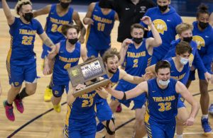 Camden Heide (23), Drew Berkland (15), Carter Bjerke (32) and Wayzata teammates celebrated with championship trophy.                         ] CARLOS GONZALEZ ¥ cgonzalez@startribune.com - Minneapolis, MN, April 10, 2021, Target Center, High School Prep Class 4A boys' basketball championship Ð Wayzata vs, Cretin-Derham Hall