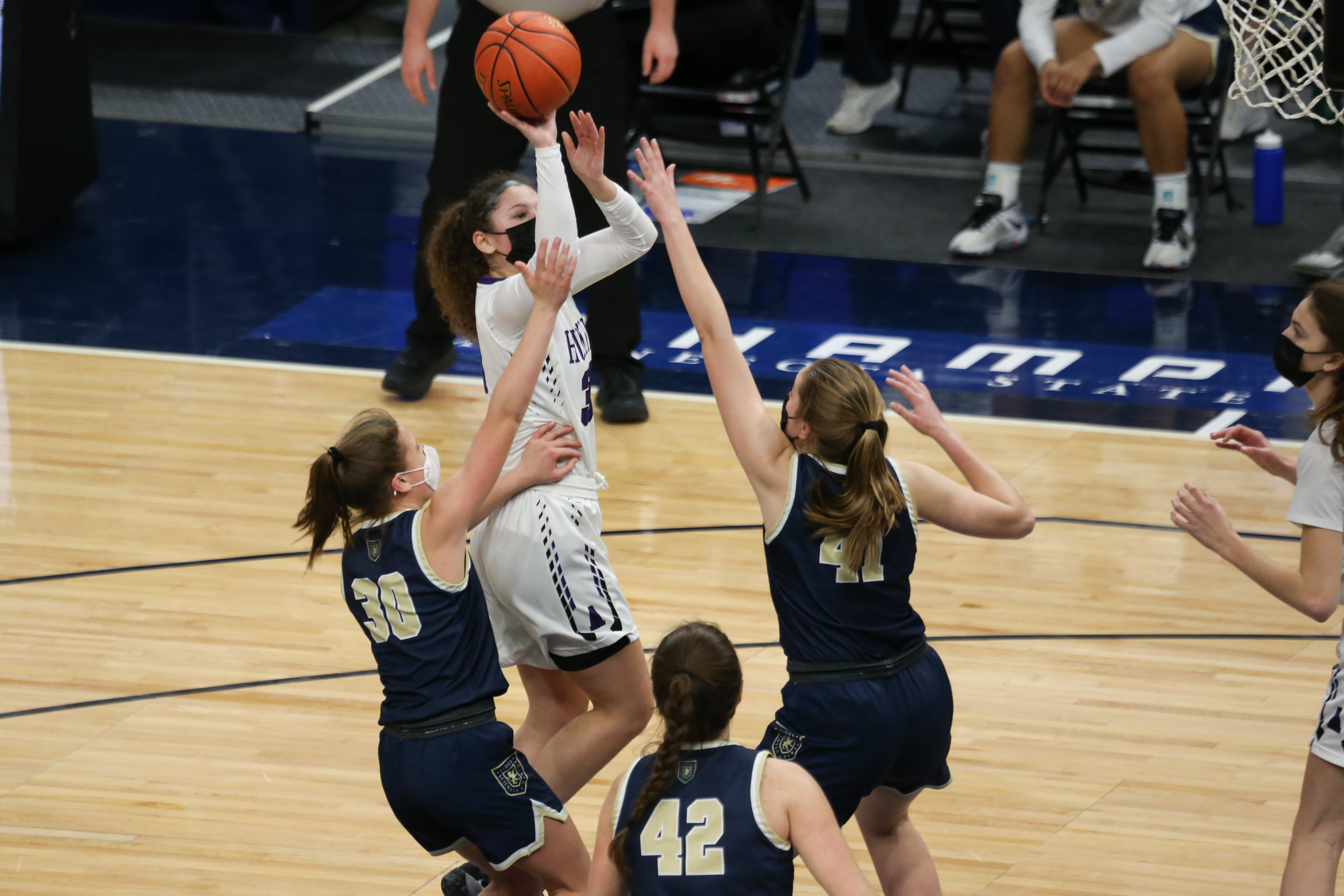 Albany's Joran Carlson (33) makes a short jump shot over two Providence Academy defenders during the first half of Friday's Class 2A championship game at Target Center. Photo by Jeff Lawler, SportsEngine