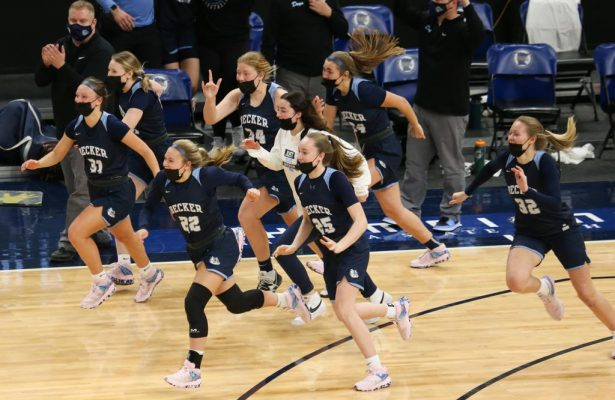 Becker players stream onto the floor to celebrate their 70-58 victory over Marshall in the Class 3A championship game at Target Center Friday night. Photo by Jeff Lawler, SportsEngine