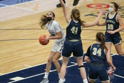 Albany's Kylan Gerads (45) looks for room under the basket as Providence Academy's Grace Counts (41) impedes her progress. The Huskies defeated the Lions 57-43 in Friday's Class 2A championship game at Target Center. Photo by Jeff Lawler, SportsEngine